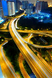 Highway at night in modern city Stock Photos