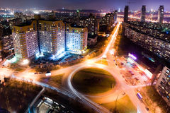 Highway at night in modern city. Aerial view of cityscape Royalty Free Stock Photography