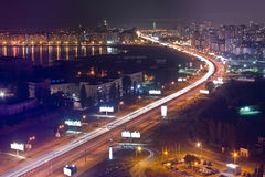 Highway at night in modern city. Aerial view of cityscape Royalty Free Stock Image