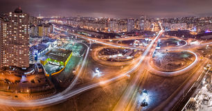 Highway at night in modern city. Aerial view of cityscape Stock Photos