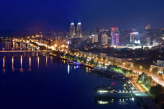 Highway at night in modern city. Aerial view of cityscape Royalty Free Stock Photo
