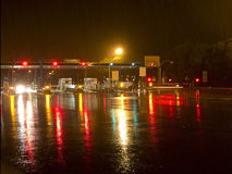 Highway at night in the rain. With colored reflections on the asphalt Royalty Free Stock Photography