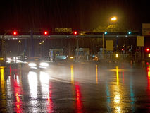 Highway at night in the rain. With colored reflections on the asphalt Royalty Free Stock Images