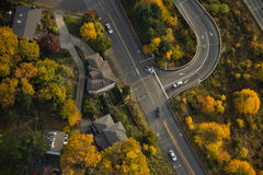 Highway Off-Ramp in Autumn. Aerial view of interstate exit surrounded by yellow trees Royalty Free Stock Image