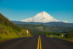 Highway in Oregon with Mount Hood in the background. Eastern side of Mount Hood rising above a highway in Oregon Stock Photo