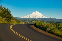 Highway in Oregon with Mount Hood in the background. Eastern side of Mount Hood rising above a highway in Oregon Royalty Free Stock Image