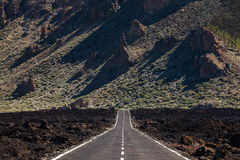 Highway over lava flow. Scenic highway or road over an old lava flow near Mt. Teide Volcano, Tenerife, Canary Islands Stock Images