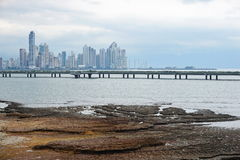 Highway over the ocean and Panama city skyscrapers Royalty Free Stock Images