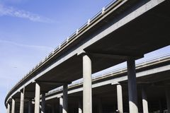 Highway Overpass. Contrasting Pillars of a Highway Overpass With a Bright Blue Sky Stock Photos