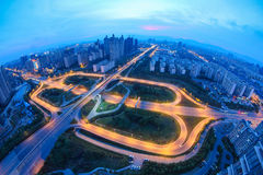 Highway overpass at dusk. Panoramic view of the highway overpass at dusk in modern city Royalty Free Stock Photography