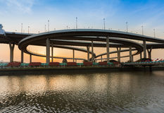 Highway overpass intersection water front with sunset sky background Stock Photo
