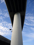 Highway overpass on large pillars towers in the sky Royalty Free Stock Photography
