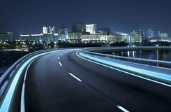 Highway overpass motion blur with city Stock Photos