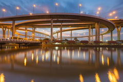 Highway overpass ring intersection during twilight river front view Stock Photo