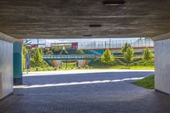 Highway, overpasses and concrete columns. Sound absorbing screens are metal frames filled with glass.View from the tunnel. Modern technology in Poland royalty free stock photography