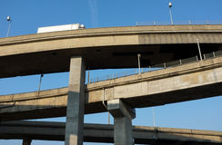 Highway overpasses criss-crossing. Truck driving on highway overpass that criss-crosses with others Royalty Free Stock Photos