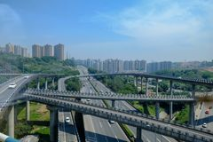 Highway overpasses in downtown China. Highways and winding overpasses crossing each other in Chongquing, China with highrise buildings in the background Stock Images
