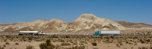 Highway panorama with trucks Royalty Free Stock Image