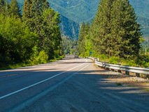 Highway Parallels a Wide Mountain River Stock Images
