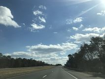 Highway. Park river cold trees clouds sun Stock Photos