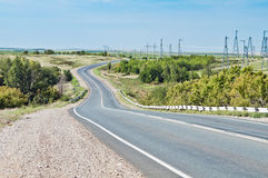 Highway passes through the steppe Stock Photos