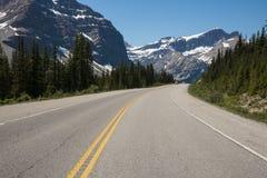 Highway passing below mountains Stock Image