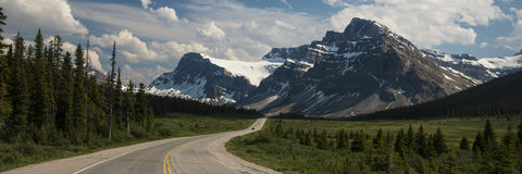 Highway passing below mountains Royalty Free Stock Photography