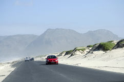 Highway passing sand dunes in South Africa Royalty Free Stock Photo