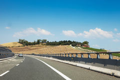 Highway passing Tuscany villages Stock Photo
