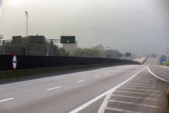 Highway in perspective, with morning fog royalty free stock images