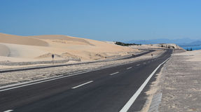 Highway Phan Ri with sand hill in Mui Ne town, Vietnam Royalty Free Stock Photography