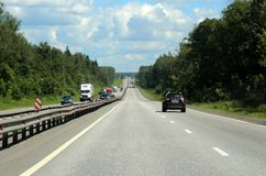 Highway through the picturesque forest. 126 kilometers from Moscow. Stock Photos