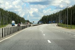 Highway through the picturesque forest. 123 kilometers from Moscow. Royalty Free Stock Photos