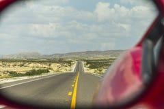 Highway through rear mirror Stock Photo