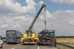 Highway Recovery Coach. Belgrade, Serbia - June 03, 2018: Burned Coach Bus at Highway Recovery Assistance Near Belgrade, Serbia royalty free stock image