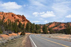 Highway in Red Canyon. Highway receding through Red Canyon towards, Bryce Canyon, Utah, U.S.A Royalty Free Stock Images