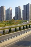 Highway and residential buildings Royalty Free Stock Images