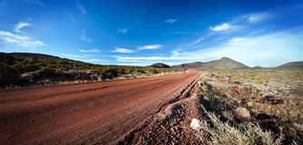 Highway on Reunion island. Panoramic view of highway receding through volcanic landscape of Reunion Island stock photos