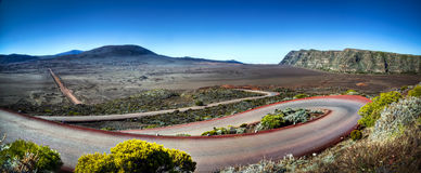 Highway on Reunion Island. Scenic view of winding highway in landscape of Plaine des Sables, Reunion Island National Park royalty free stock image