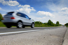 Highway road. Car on a road in the summer with a nice cloudy blue sky Royalty Free Stock Photography