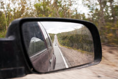 Highway road. Straight highway road with cars in rear-view mirror Royalty Free Stock Photos