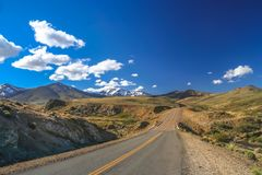 Highway road through Argentinia. Famous Ruta 40 called also Ruta Quarenta passing through some impressive and strangely shaped mountains in northern part of the Royalty Free Stock Photo