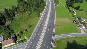Highway road on a bridge with traffic. Aerial shoot of a highway road on a bridge with traffic of cars and trucks in a valley stock video footage