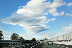 Highway road, cars, guardrail, sky and clouds. Highway road, cars, guardrail, blue sky and clouds Stock Photography