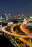 Highway road curved long exposure with city downtown Royalty Free Stock Photo