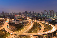 Highway road curved long exposure with city downtown Stock Photos