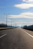 Highway road. With empty lanes on a bright day Stock Photos