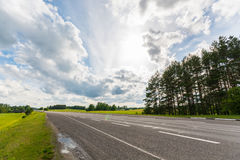 Highway road. Fields and clouds. Stock Image