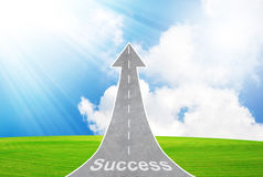 Highway road going up as an arrow symbolizing success, growth Stock Photos