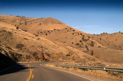 Highway Road with hills. In Colorado Royalty Free Stock Photo
